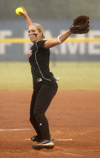 Yukon's Maddy L. Ellis (13) pitches during a 6A state softball semifinals game between Edmond North and Yukon at ASA Hall of Fame Stadium in Oklahoma City, Okla., Friday, Oct. 12, 2012.  Photo by Garett Fisbeck, The Oklahoman