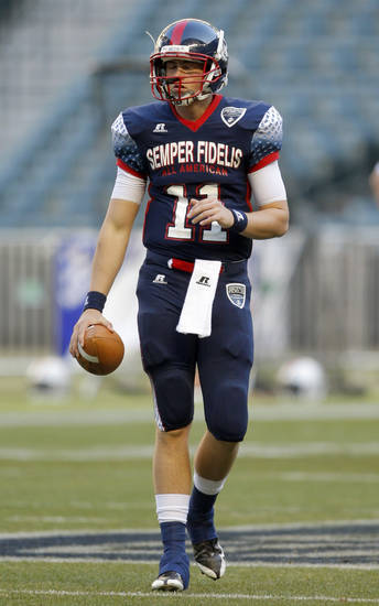 Wes Lunt warms up in the Semper Fidelis All-American Bowl at Chase Field in Phoneix, Ariz., Tuesday, Jan. 3, 2012. Photo by Sarah Phipps, The Oklahoman