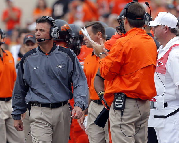 Oklahoma State head football coach Mike Gundy coaches during a college football game between Oklahoma State University (OSU) and the University of Louisiana-Lafayette (ULL) at Boone Pickens Stadium in Stillwater, Okla., Saturday, Sept. 15, 2012. Photo by Sarah Phipps, The Oklahoman