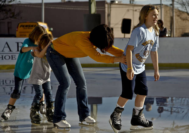 Eve Brennan leads the line skate at the Edmond outdoor ice skating rink in Edmond. Photo by Chris Landsberger, The Oklahoman. <strong>CHRIS LANDSBERGER - CHRIS LANDSBERGER</strong>