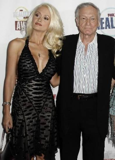 Holly Madison, poses with Hugh Hefner in this Sept. 2008 Associated Press photo. The two were dating but have since broken up.