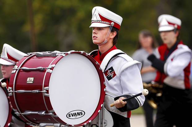 Hunter Billen, a sophomore, plays the bass drum  while marching with the band.   Carl Albert High School is celebrating its 50th birthday this year and students and alumni participated in homecoming week activities, including a two-mile long parade before the football game on Friday, Oct. 12, 2012.    Photo by Jim Beckel, The Oklahoman