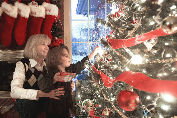 Virginia Greer and her granddaughter, Maddie, 3, admire the Christmas tree. PHOTO BY SARAH PHIPPS, THE OKLAHOMAN