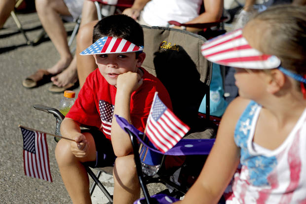 Carson Wallace, 6, of Edmond watches the LibertyFest Fourth of July Parade in Edmond, Okla., Wednesday, July 4, 2012. Photo by Bryan Terry, The Oklahoman