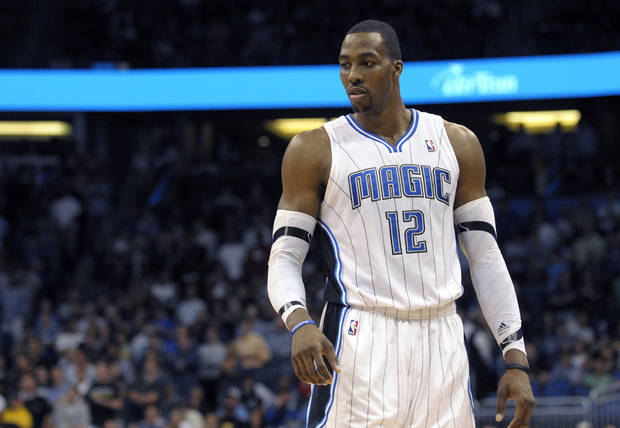 FILE -This file photo taken March 13, 2012, shows Orlando Magic center Dwight Howard during an NBA basketball game in Orlando, Fla. The Los Angeles Lakers have a deal in place to acquire Dwight Howard from Orlando in a four-team, eight-player trade also involving Denver and Philadelphia, and the NBA has scheduled a conference call Friday Aug. 10, 2012 with the four general managers to finish the deal, according to multiple reports. (AP Photo/Phelan M. Ebenhack, file) ORG XMIT: NY116