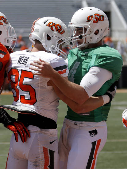 Oklahoma State's J. W. Walsh, at right, celebrates with Blake Webb after a touchdown pass to Webb during the OSU spring football game at Boone Pickens Stadium in Stillwater, Okla., Sat., April 20, 2013. Photo by Bryan Terry, The Oklahoman