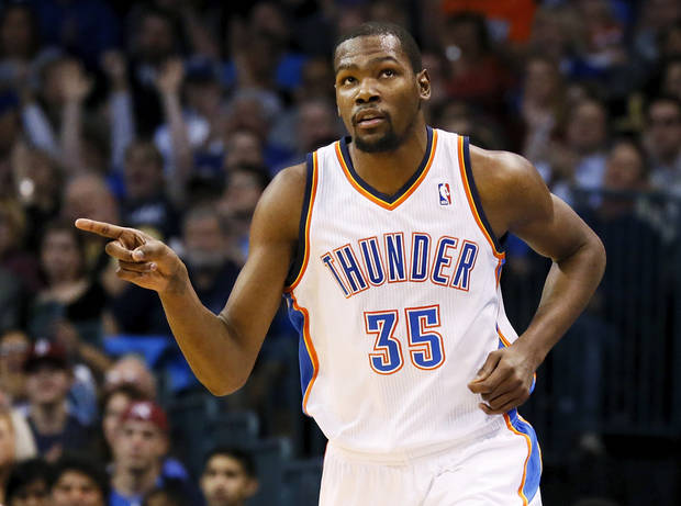 Oklahoma City's Kevin Durant (35) reacts after making a basket during an NBA basketball game between the Oklahoma City Thunder and the San Antonio Spurs in Oklahoma City Monday, Dec. 17, 2012. Photo by Nate Billings, The Oklahoman
