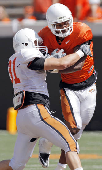 OSU's Brandon Speth (31) tries to stop Joseph Randle (1) on a carry during the Orange/White spring football game for the Oklahoma State University Cowboys at Boone Pickens Stadium in Stillwater, Okla., Saturday, April 16, 2011. Photo by Nate Billings, The Oklahoman