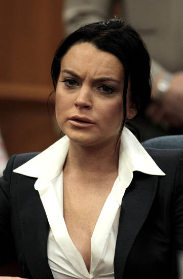 Actress Lindsay Lohan appears in a courtroom for a hearing in Beverly Hills, Calif., Monday, May 24, 2010. (AP Photo/Jae C. Hong, Pool) ORG XMIT: CAJH107