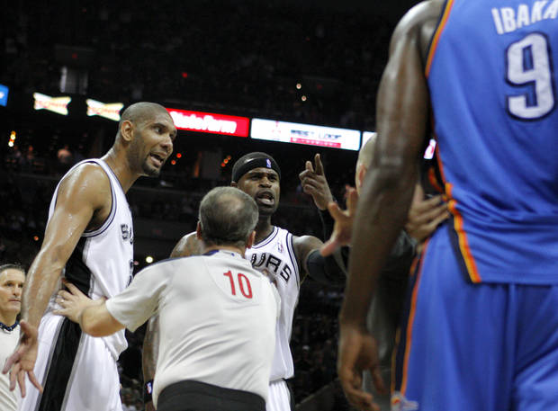 San Antonio's Tim Duncan (21) and Stephen Jackson (3) argue with official Ron Garretson as Oklahoma City's Serge Ibaka (9) watches during Game 2 of the Western Conference Finals between the Oklahoma City Thunder and the San Antonio Spurs in the NBA playoffs at the AT&T Center in San Antonio, Texas, Tuesday, May 29, 2012. Oklahoma City lost 120-111. Photo by Bryan Terry, The Oklahoman