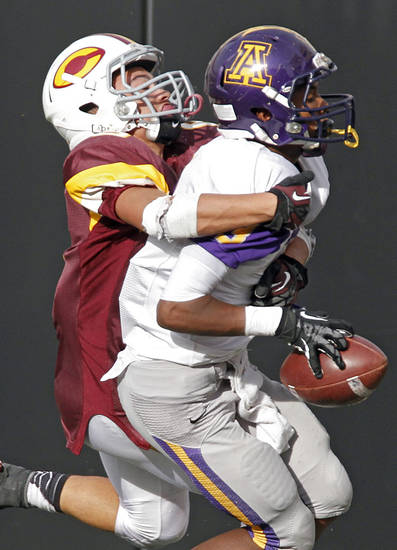 Anadarko's Josh Parton (3) makes an interception in front of Clinton's Devon Mitchell (6) during the Class 4A Oklahoma state championship football game between Anadarko and Clinton at Boone Pickens Stadium on Saturday, Dec. 1, 2012, in Stillwater, Okla.   Photo by Chris Landsberger, The Oklahoman