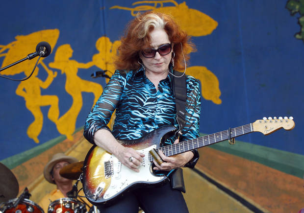 Bonnie Raitt performs at the New Orleans Jazz and Heritage Festival in New Orleans, Sunday, May 6, 2012. (AP Photo/Gerald Herbert)
