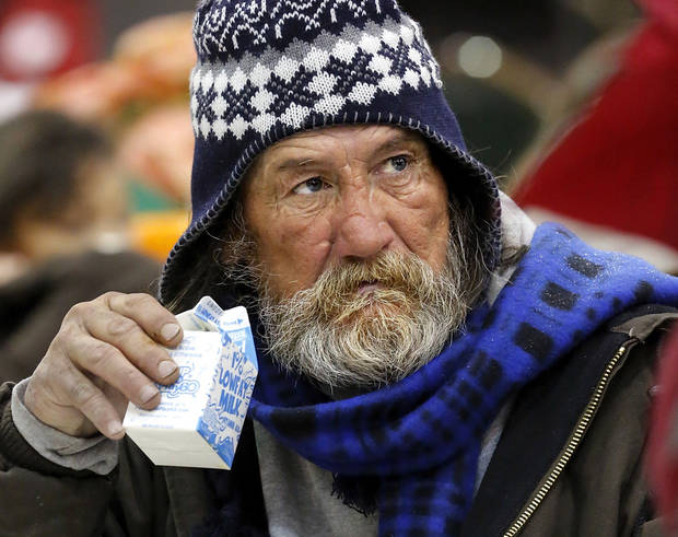 David Graves, who said he is homeless after his wife passed away several years ago, attends the Red Andrews Christmas Dinner on Tuesday at the Cox Convention Center. He said his life fell apart, and he wasn�t able to get things together without her. Graves said the volunteers� efforts at the dinner made it a merry Christmas for him.