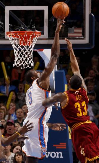 Oklahoma City's Serge Ibaka (9) blocks the shot of Cleveland's Alonzo Gee (33) during the NBA basketball game between the Oklahoma City Thunder and the Cleveland Cavaliers at Chesapeake Energy Arena in Oklahoma City, Friday, March 9, 2012. Photo by Bryan Terry, The Oklahoman