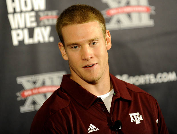 Texas A&M quarterback Ryan Tannehill answers questions during NCAA college football Big 12 Media Days, Monday, July 25, 2011, in Dallas. (AP Photo/Matt Strasen)