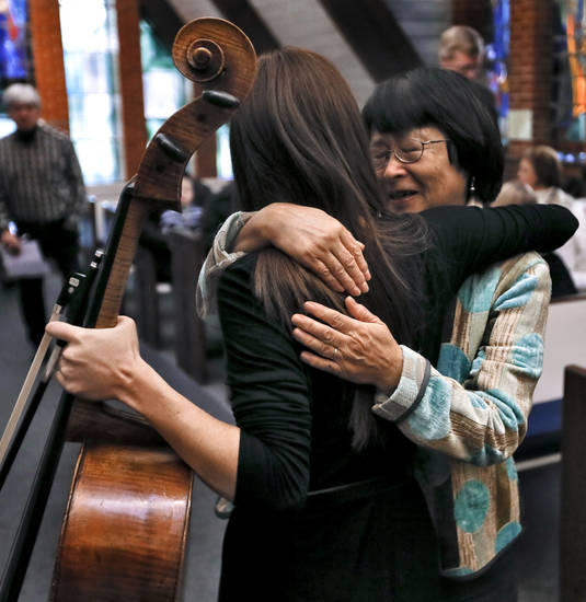 Hiromi Hood hugs her daughter Mika Marie Hood during the Hood Family Recital.  Photo by Chris Landsberger, The Oklahoman <strong>CHRIS LANDSBERGER - CHRIS LANDSBERGER</strong>