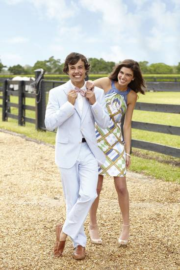 "Spring gets preppy Kentucky Derby style in Vineyard Vines' blue cotton seersucker suit complete with mint julep bow tie for him and ""Bitsy"" silk printed shift dress for her. Vineyard Vines is the official clothing sponsor of the Kentucky Derby. To view the entire collection, visit www.vineyardvines.com."
