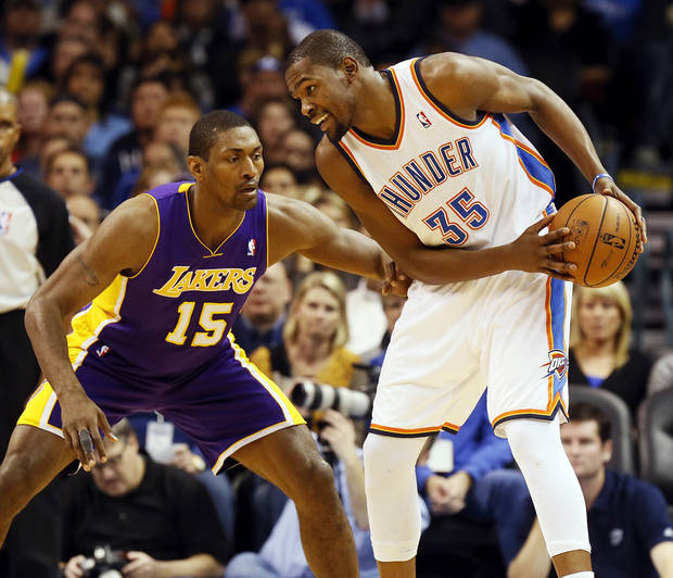 Oklahoma City&#039;s Kevin Durant (35) keeps the ball away from Los Angeles&#039; Metta World Peace (15) during an NBA basketball game between the Oklahoma City Thunder and the Los Angeles Lakers at Chesapeake Energy Arena in Oklahoma City, Friday, Dec. 7, 2012. Oklahoma City won, 114-108. Photo by Nate Billings, The Oklahoman