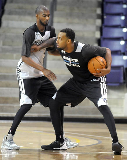 Minnesota Timberwolves' Derrick Williams is guarded by teammate Corey Brewer during the NBA basketball team's training camp Tuesday, Oct. 1, 2013, in Mankato, Minn. (AP Photo/Mankato Free Press, Pat Christman)