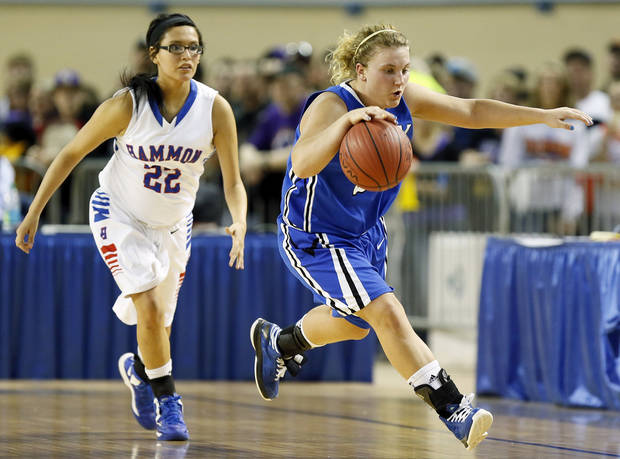 Lomega's Ashley LaGasse (22) steals the ball from Hammon's Jamie Highwalker (22) and takes off on a fast break during a Class B Girls semifinal game of the state high school basketball tournament between Hammon and Lomega at Jim Norick Arena, The Big House, on State Fair Park in Oklahoma City, Friday, March 1, 2013. Lomega won, 60-52. Photo by Nate Billings, The Oklahoman