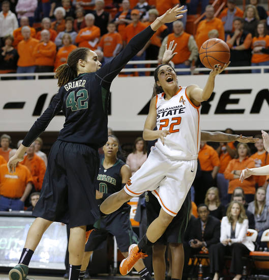 Oklahoma State's Brittney Martin (22) goes to the basket Baylor's Brittney Griner (42) during a women's college basketball game between Oklahoma State University and Baylor at Gallagher-Iba Arena in Stillwater, Okla., Saturday, Feb. 2, 2013. Photo by Bryan Terry, The Oklahoman