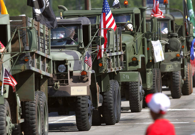 The Oklahoma Convoy, comprised of military trucks, rolls down Sunnylane Road during the Armed Forces Day parade in Del City, Saturday morning,  May 11, 2013. Photo  by Jim Beckel, The Oklahoman.