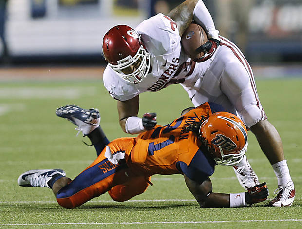 Oklahoma Sooners fullback Trey Millard (33) is brought down by UTEP's Derrick Morgan (21) during the college football game between the University of Oklahoma Sooners (OU) and the University of Texas El Paso Miners (UTEP) at Sun Bowl Stadium on Saturday, Sept. 1, 2012, in El Paso, Tex.  Photo by Chris Landsberger, The Oklahoman