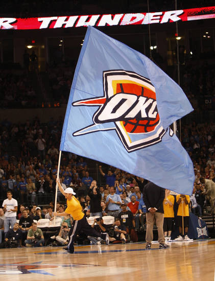 FIRST REGULAR SEASON WIN: An Oklahoma City Thunder flag is carried onto the court during a break in the action of an NBA basketball game between the Thunder and the Minnesota Timberwolves in Oklahoma City, Sunday, Nov. 2, 2008. Oklahoma City won 88-85. (AP Photo/Sue Ogrocki) ORG XMIT: OKSO108