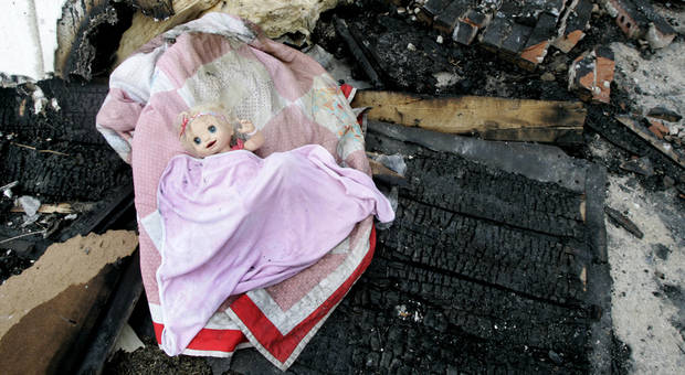 This doll survived the house fire at 599 Fern Lane that was destroyed in a wildfire in Choctaw, Oklahoma April 10, 2009.  Photo by Steve Gooch, The Oklahoman