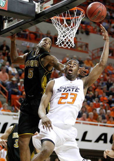 OSU's James Anderson goes to the basket past Misouri's Leo Lyons during the Big 12 college basketball game between Oklahoma State and Missouri at Gallagher-Iba Arena in Stillwater, Okla., Wednesday, Jan. 21, 2009.  PHOTO BY BRYAN TERRY, THE OKLAHOMAN