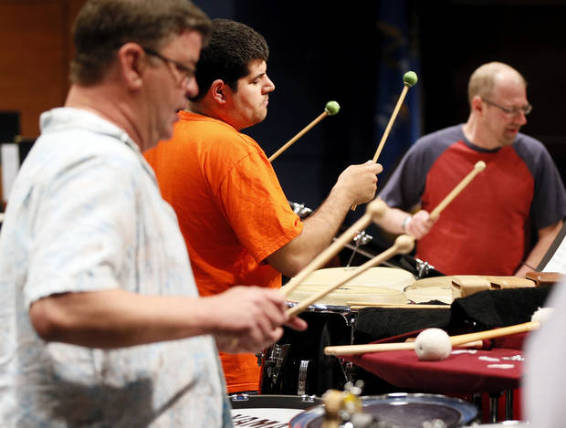 "From left, Roger Owens, Stuart Langsam and Steve Craft rehearse Christopher Rouse's ""Ogoun Badagris"" for the Oklahoma City Philharmonic's 2012-13 season finale.   Photo by Nate Billings, The Oklahoman <strong>NATE BILLINGS - NATE BILLINGS</strong>"