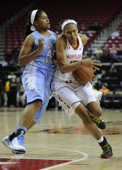 Maryland's Alicia DeVaughn, right, is pushed by North Carolina's Tierra Ruffin-Pratt during the first half of an NCAA college basketball game onThursday, Jan. 24, 2013, in College Park, Md. (AP Photo/Gail Burton).