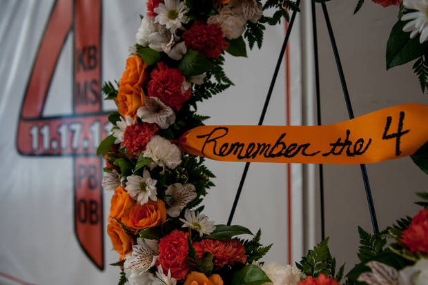 "A wreath is set in front of the ""Remember the 4"" banner Friday in Gallagher-Iba Arena in Stillwater. Photo by Mitchell Alcala for The Okahoman <strong>Mitchell Alcala - Mitchell Alcala for the Oklahoma</strong>"
