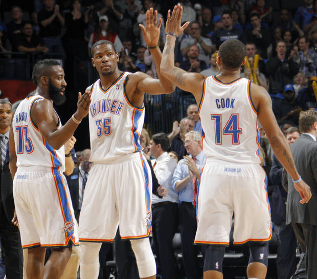 Oklahoma City Thunder small forward Kevin Durant (35) celebrates the win over Boston with Oklahoma City Thunder guard James Harden (13) and Oklahoma City Thunder shooting guard Daequan Cook (14) during the NBA basketball game between the Oklahoma City Thunder and the Boston Celtics at the Chesapeake Energy Arena on Wednesday, Feb. 22, 2012 in Oklahoma City, Okla.  Photo by Chris Landsberger, The Oklahoman