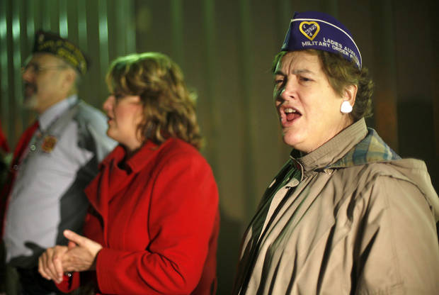 Margaret Schipper sings Christmas  carols as troops from Ft. Sill arrive at the YMCA Military Welcome Center at Will Rogers World Airport, Saturday, Dec. 18, 2010, in Oklahoma City. Photo by Sarah Phipps, The Oklahoman