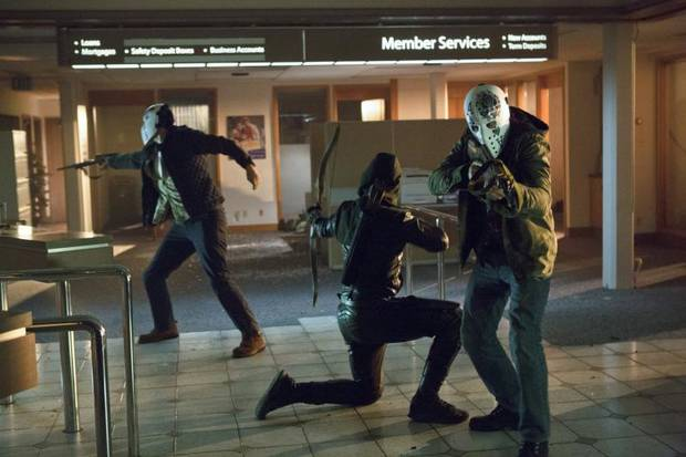 """Arrow -- """"Legacies"""" -- Image AR106a_3519b -- Pictured (L-R): Currie Graham as King, Stephen Amell as Arrow and Kyle Schmid as Ace -- Photo: Jack Rowand/The CW -- ©2012 The CW Network. All Rights Reserved"""