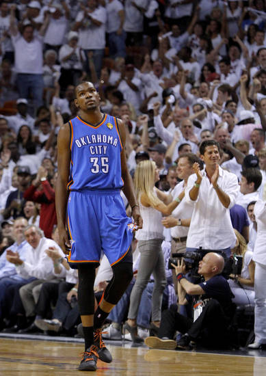 Heat fans cheer as OKC�s Kevin Durant watches time expire in Game 5 of the NBA Finals last season in Miami. Tuesday�s Christmas Day game is the first opportunity for the Thunder to demonstrate what they learned from falling 4-1 in the championship series. Photo by Bryan Terry, The Oklahoman Archives
