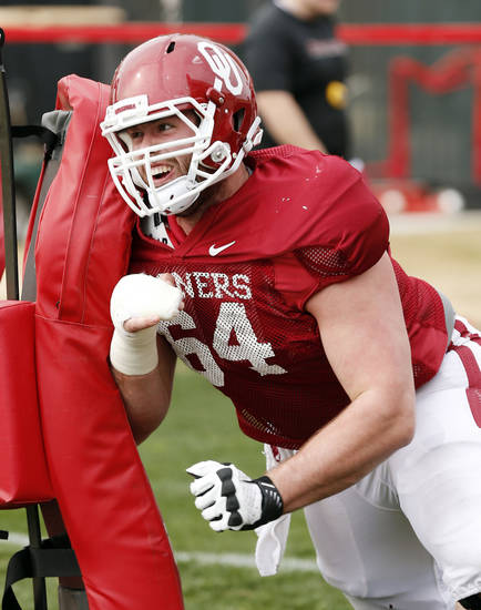 OU center Gabe Ikard said after practice Monday that he�s participating in individual drills, but can�t do much else because of his broken hand.  PHOTO BY STEVE SISNEY, The Oklahoman