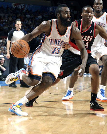 Oklahoma City's James Harden (13) drives to the basket as Portland 's Nolan Smith (4) defends during the NBA basketball game between the Oklahoma City Thunder and the Portland Trail Blazers at Chesapeake Energy Arena in Oklahoma City, Sunday, March 18, 2012. Photo by Sarah Phipps, The Oklahoman.