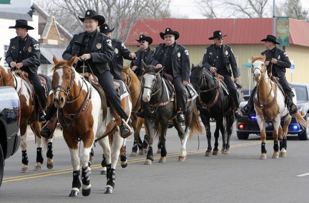 Members of the Oklahoma County Sheriff's Dept. ride in the Stockyards City Christmas parade in Oklahoma City, OK, Saturday, December 1, 2012,  By Paul Hellstern, The Oklahoman