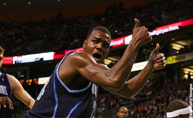 BOSTON - DECEMBER 15:  Paul Millsap #24 of the Utah Jazz signals that it is a jump ball as Rajon Rondo #9 of the Boston Celtics holds the ball on December 15, 2008 at TD Banknorth Garden in Boston, Massachusetts. The Celtics defeated the Jazz 100-91. NOTE TO USER: User expressly acknowledges and agrees that, by downloading and or using this Photograph, user is consenting to the terms and conditions of the Getty Images License Agreement.  (Photo by Elsa/Getty Images) *** Local Caption *** Paul Millsap;Rajon Rondo