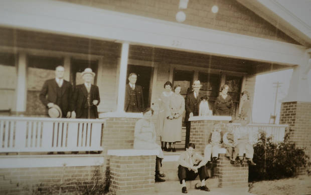 The Ekdol family of Britton gathers on the front porch of their home in the late 1930s. <strong>Zeke Campfield - Oklahoman</strong>