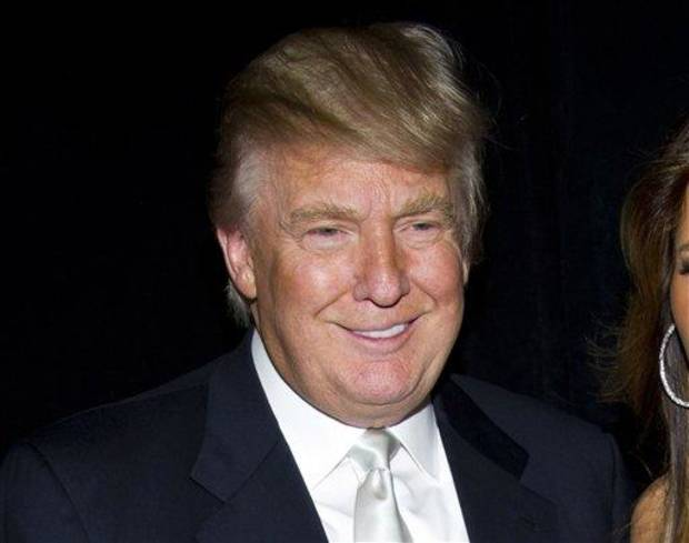 "FILE - In this Nov. 14, 2011 file photo, Donald Trump attends the Friars Club's Testimonial Dinner honoring Larry King, in New York. Trump has launched a new men's fragrance called ""Success."" (AP Photo/Charles Sykes, file)"