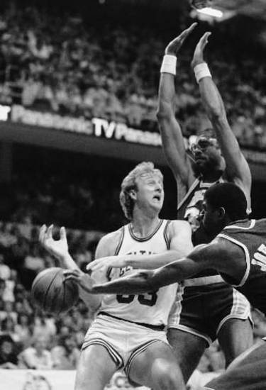 In this May 27, 1984, file photo, Los Angeles Lakers&#039; Magic Johnson, right, knocks the ball from Boston Celtics&#039;  Larry  Bird during a game in the NBA championship series at the Boston Garden in Boston. (AP Photo/Mike Kullen, File) 