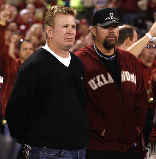 Former Oklahoma assistant coach Mike Stoops and Toby Keith stand before the college football game between the University of Oklahoma Sooners (OU) and Texas Tech at Gaylord Family-Oklahoma Memorial Stadium in Norman, Kansas, Saturday, Oct. 22, 2011. Photo by Bryan Terry, The Oklahoman
