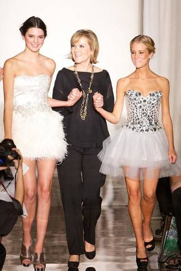 Kendall Jenner, designer Sherri Hill and Cassidy Gifford walk the runway at the end of Hill's spring 2012 show in New York.