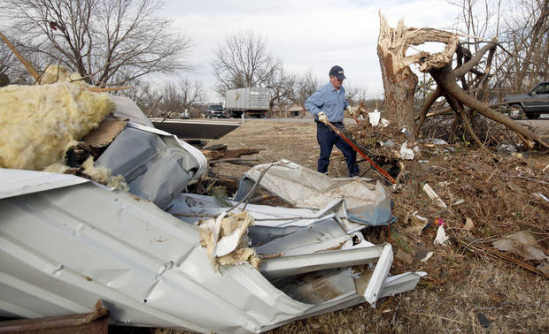 Mike Rolen cleans up tornado damage in the Majestic Hills neighborhood north of Ardmore, Thursday, Feb. 12, 2009, PHOTO BY SARAH PHIPPS, THE OKLAHOMAN