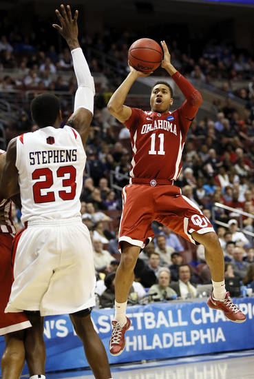 Oklahoma's Isaiah Cousins (11) shoots near San Diego State's DeShawn Stephens (23) during a game between the University of Oklahoma and San Diego State in the second round of the NCAA men's college basketball tournament at the Wells Fargo Center in Philadelphia, Friday, March 22, 2013. Photo by Nate Billings, The Oklahoman