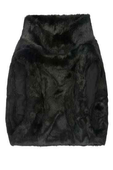 "Collection's black fur ""Gunner"" vest, $575; at 3NY, Manhattan; Brooklyn Fox, Brooklyn; or for more info visit ttcollection.com. (MCT)"