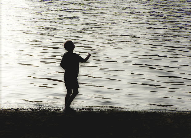 My son,Eric,throwing rocks in the Mississippi River at Vicksburg, Mississippi. (digitally enhanced)<br/><b>Community Photo By:</b> Cindi Tennison<br/><b>Submitted By:</b> Cindi , Bethany